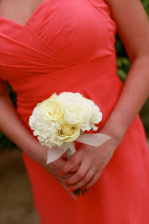 Close-up of a bridesmaid holding their wedding bouquets  photo