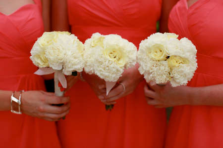 Close-up of bridesmaids holding their wedding bouquets  photo