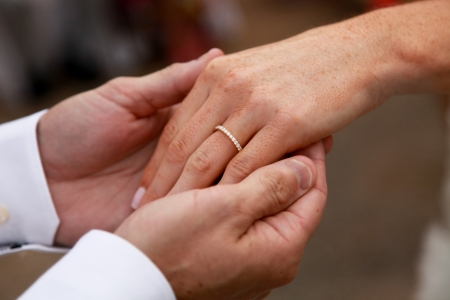 Bride and groom exchanging rings during a wedding ceremony