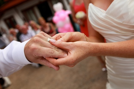 Bride and groom exchanging rings during a wedding ceremony  Stock Photo - 13456247