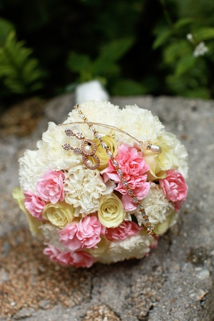 Beautiful wedding bouquet and gold bridal accessories. photo