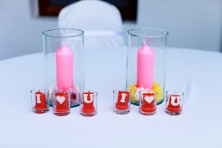 I Love You candles on a table at a wedding reception. photo
