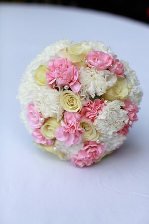 Beautiful wedding bouquet in white, yellow and pink flowers. photo