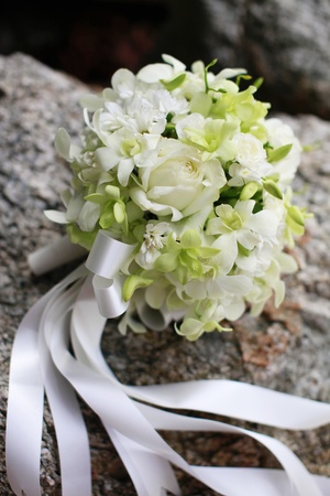 destination scenics: Beautiful wedding bouquet of white orchids and roses.