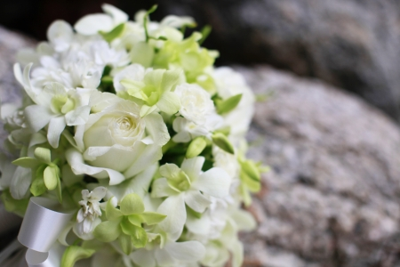 venue: Beautiful wedding bouquet of white orchids and roses.