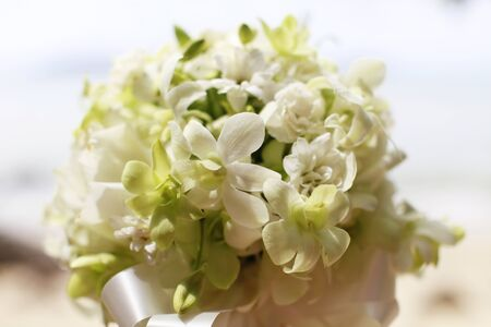 destination wedding: Beautiful wedding bouquet of white orchids and roses.