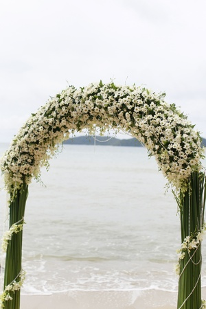 archway: Ceremony set-up for a wedding in beach Thailand. Stock Photo