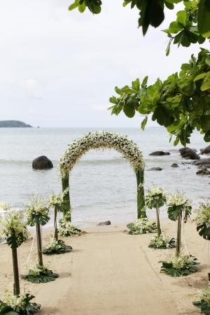 floral arrangements: Ceremony set-up for a wedding in beach Thailand. Stock Photo