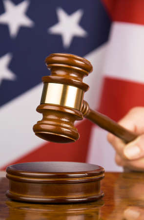 proceedings: Gavel and american flag, symbol for jurisdiction Stock Photo