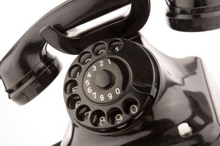 conection: black retro telephon on white Stock Photo