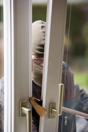 Burglar breaks into a residential building. Stock Photo - 2726279