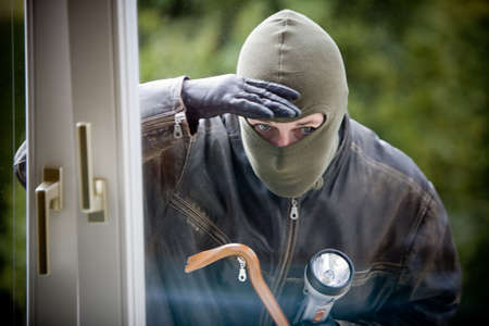 Burglar breaks into a residential building.