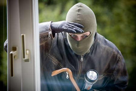 Burglar breaks into a residential building. Stock Photo - 2726274