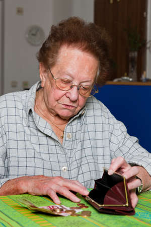 existence: Old woman counts her money Stock Photo