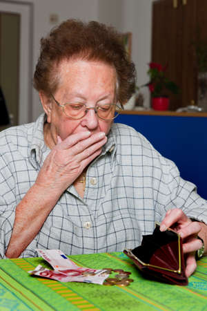 poor woman: Old woman counts her money Stock Photo