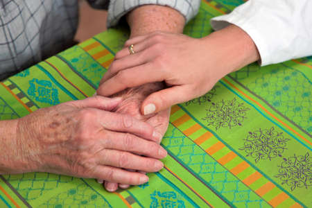 Hands nurse and an old woman Stock Photo - 4318918