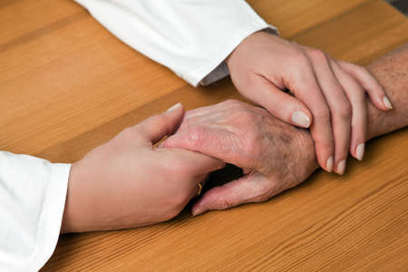 nursing record: Hands nurse and an old woman
