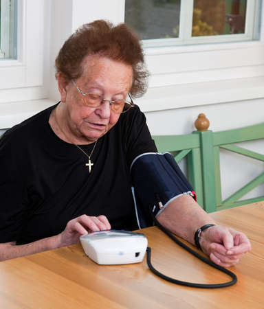 measured: An old woman measured her blood pressure