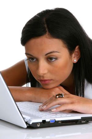 A pensive young woman with a laptop computer Stock Photo - 4347103