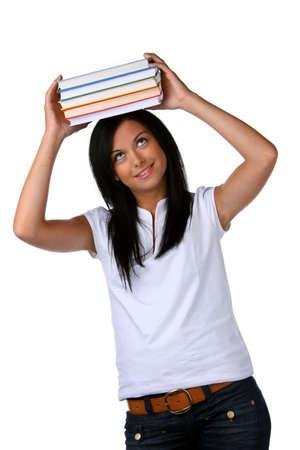 pile of books: Giovane donna con una pila di libri in testa Archivio Fotografico