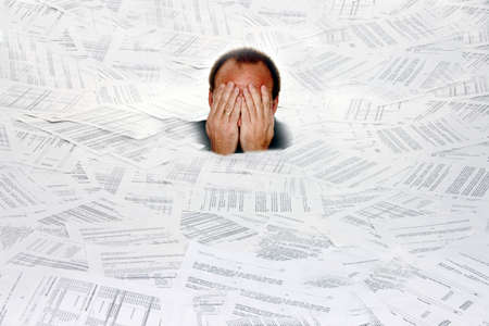 bureaucracy: Stress by bureaucracy and paper filing Stock Photo