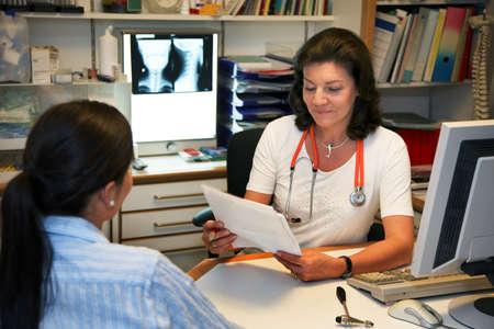 Doctor patient in conversation Stock Photo