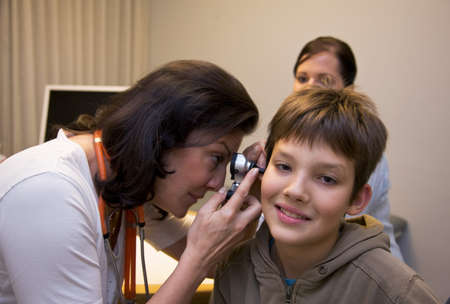Doctor examines a young patient photo