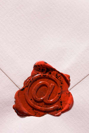 Empty envelope with e-mail sign as a seal photo