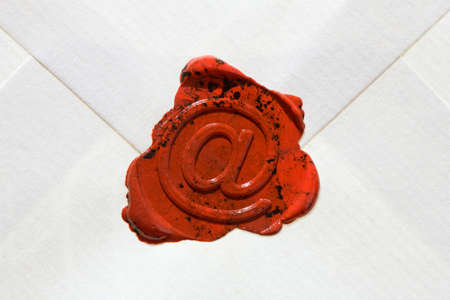 electronically: Empty envelope with e-mail sign as a seal Stock Photo