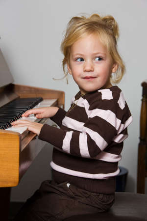 played: Child played on a piano