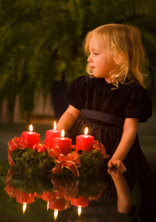 Child with Advent wreath at Christmas photo
