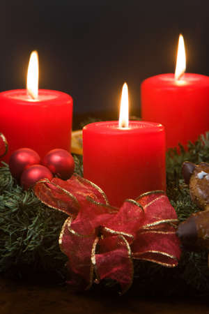 advent candles: Four burning candles on the Advent wreath