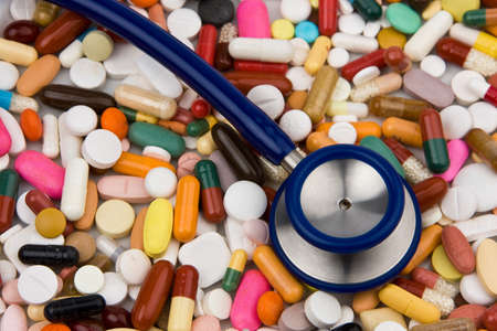 placebo: Tablets and a stethoscope to healing Stock Photo