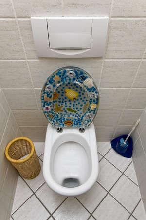 toilet seat: Toilet with an open toilet seat