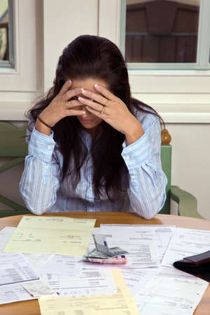 debt collection: A woman with unpaid bills