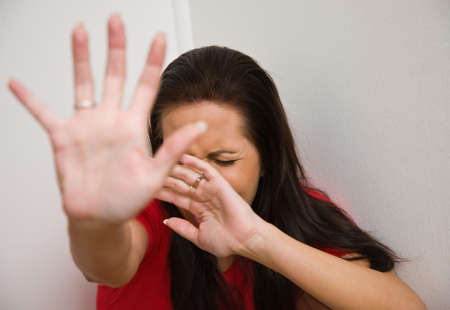Timid woman symbol of violence in the family Stock Photo - 4413000