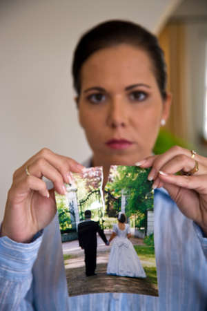 woman ripping her wedding photo Stock Photo - 4413021