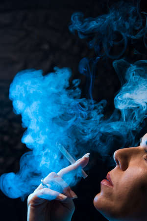 A smoking woman with a cigarette  Stock Photo - 4413014