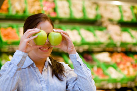 Young woman in the supermarket to buy food and a fruit Stock Photo - 4413032