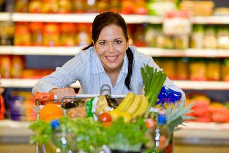 Young woman in the supermarket to buy food and a fruit Stock Photo