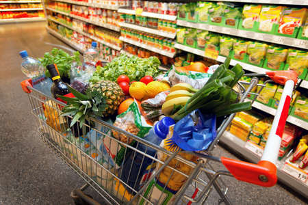 grocery cart: Full inkaufswagen with fruit vegetable food in supermarket Stock Photo