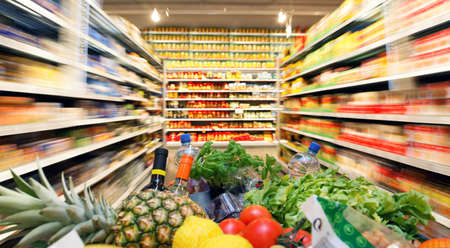 grocery shopping: Full inkaufswagen with fruit vegetable food in supermarket Stock Photo