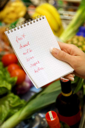 British shopping list in a supermarket with a shopping trolley Stock Photo