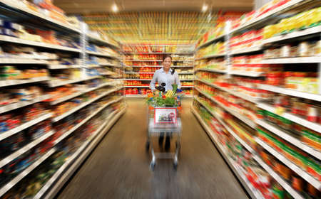 shopping list: Woman in a supermarket to buy fresh food Stock Photo