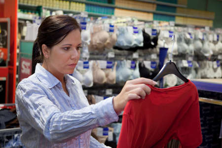 Young woman in a textile market with clothing Stock Photo - 4413024