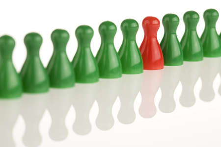 dissenting: red piece between green pieces aon a white background