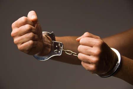 Handcuffs - symbol for crime Stock Photo - 4428423