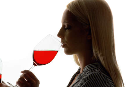 Young Woman with a glass of red wine for wine tasting Stock Photo - 4437923