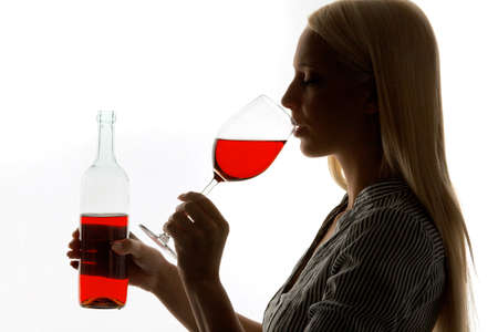 prohibitions: Young Woman with a glass of red wine for wine tasting Stock Photo