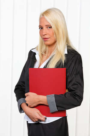 apprenticeships: Young woman with application kit before the interview